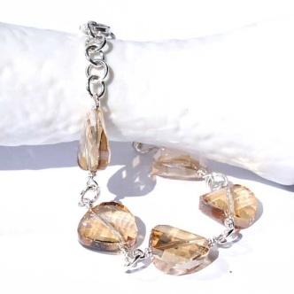 Gyldne gullskimrende krystaller - armbånd http://epla.no/handlaget/produkter/712604/