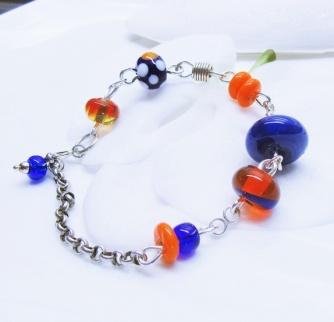 Kimmelinessmykker Sølv armbånd i blått og orange http://epla.no/handlaget/produkter/807191/