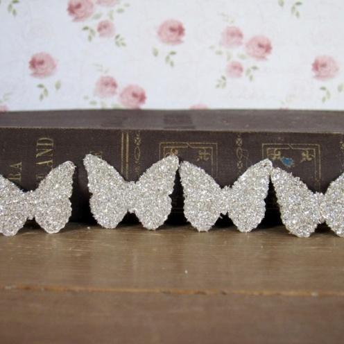 CIRKELINE DESIGN: 10 sølv sommerfugler https://www.epla.no/handlaget/produkter/850918/